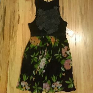 Free People dress. Has tags. But has tear too.